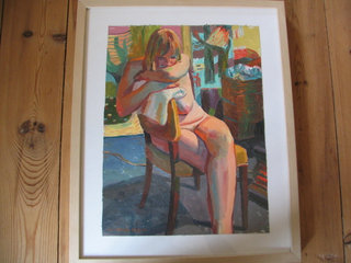 Girl resting on chair and towel
