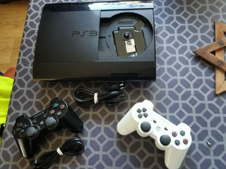 Ps3 super slim 12gb + 500gb harddisk